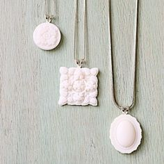 Mimic the look of milk glass and create these easy necklace pendants with your glue gun.