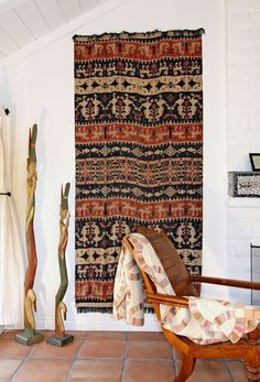 eclectic living room by Shelley Gardea  1950s vintage ikat wall hanging from Sumba, Indonesia  sculptures are from Bali