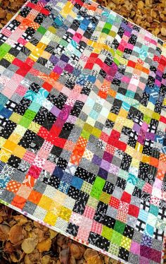 rainbow scrappy charming plus quilt (2). Can also make one block of all yellow crumbs instead of a whole piece of yellow fabric, or combine black & white crumbs