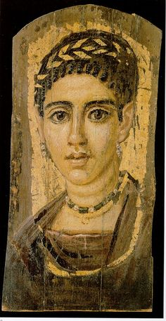 Portrait of a Young Woman with a Gilded Wreath  Egyptian, Roman Period, 120-140 A.D.  Encaustic and gold on wood , MMA