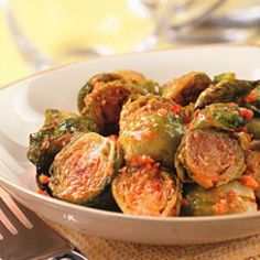 Roasted Brussels Sprouts with Sun-Dried Tomato Pesto—a yummy, easy and healthy vegetable side dish.