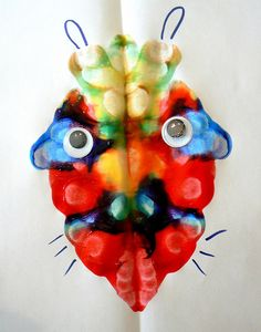 Squish paint monsters - symmetry, color blending, and abstract art. Cute!   This would work great to make dragon/lion heads for Chinese new year decor