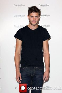 Jamie Dornan aka Christian Grey from #fiftyshadesofgrey looking casual in a plain black t-shirt and jeans