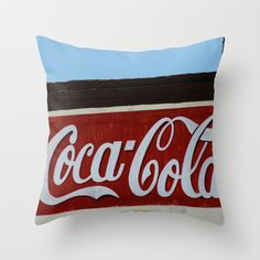Cola Throw Pillow by Ink and Paint Studio #vintage #vintagesign #retro #sign #modernhomedecor #cocacola #beverage #coke #kitchendecor
