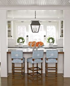 Touch of blue and tangerine in white kitchen