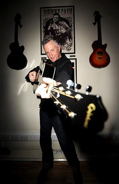 Billy Bragg poses in the Gibson guitar studio during a performance to support his Jail Guitar Doors campaign in 2008