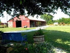 Old Pole Barn, now used for outdoor picnicking, as seen from under the Wedding Tree in the Barn Courtyard at the Civil War Ranch in Carthage, MO. Photo by Lee Hunt