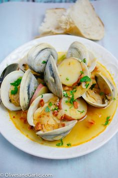 Clams, chorizo, garlic and beans. http://foodwinethyme.com/steamed-clams-with-chorizo-in-white-wine-broth/