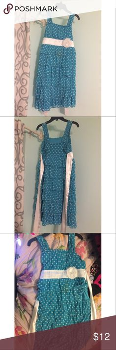 Polk a dot ruffle dress Only flaw is the stain in the center of the dress. Silk ribbon to tie the back Dresses