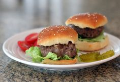 These juicy grilled burgers are flavored with grated onion and seasonings along with some tomato juice and condiments.