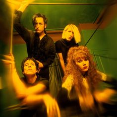 The American punk/psychobilly rock band The Cramps lead vocalist Lux Interior drummer Harry Drumdini bassist Slim Chance and lead guitarist Poison...