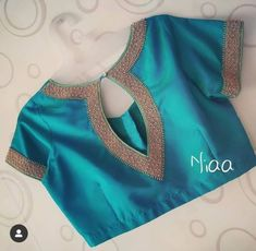 blouse designs latest Drool Worthy Latest Blouse Designs - The List Will Amaze You Great color! Blouse Designs High Neck, Pattu Saree Blouse Designs, Simple Blouse Designs, Stylish Blouse Design, Fancy Blouse Designs, Bridal Blouse Designs, Pattern Blouses For Sarees, Lehenga Designs, White Russian
