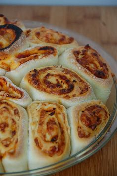 pizza roll pizza : use dough, fill with toppings roll up, slice and back in round pie plate or cake pan
