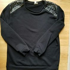 black studded sweater Oversized black sweater. Studded shoulders. Gently worn. Forever 21 Sweaters Crew & Scoop Necks