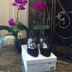 """Calvin Klein """"JIVE SUEDE/TMBL MET"""" Black suede closed toe pump w/dark metallic silver detail, laced tie. Heel is black patent leather. Size 10, runs on the small side cuz I'm normally a 9.5. Great professional shoe with a bit of fun! Worn no more than 4-5 times because I wanted to keep the suede upper looking good, so they are like new (bottom of shoes is not even worn or scuffed) Calvin Klein Shoes Heels"""