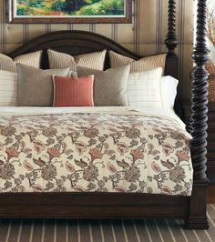 The light, crimson-tinted floral pattern and subtly textured decorative pillows give a fashionable update to a traditional set.