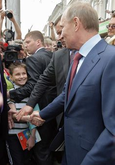 Love the look on the boy's face, and love how both him and Putin are totally ignoring security.