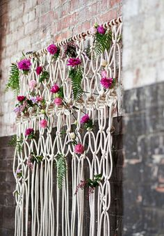 Rope with flowers in it as a wall hanging - behind the bride and groom?