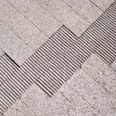 White granite pavement detail of stormwater management facilities, Director Park, Portland, Oregon.