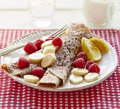 Use gluten-free flour in these thin breakfast pancakes served with almond butter, fruit and lemon