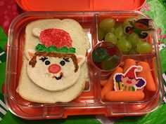 Well, the boy made his lunch tonight and did a mighty fine job!  PBNutella elf sandwich, grapes, carrots, gummy lifesavers  :)