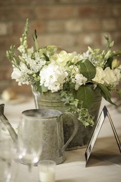 flower arrangements in rustic galvanized buckets | White Hydrangea and Rose Centerpiece in a Metal Bucket
