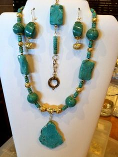 Turquoise with gold findings.