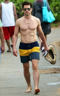 Matt Bomer Hubba hubba! The Magic Mike hunk shows off his many, many muscles on the beach in Hawaii.