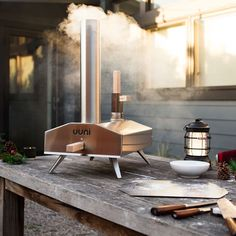"""Story  Give the gift of pizza with the award-winning UUNI wood-fired pizza oven  """"The most gorgeous thing we've ever set fire to."""" - Wired Magazine  It's a cold, crisp Saturday afternoon. College football is on. You're in the backyard. Scratch that — even better: you're at the game, tailgating. You've got a hearty Oatmeal Stout in hand. And now, thanks to the award-winning, portable UUNI Pizza Oven, you're serving up delicious, piping hot wood-fired pizza to ..."""
