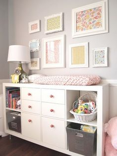 I love the fabric and paper in the white frames. Easy. Cheap. Cute. Love the white furniture with pink knobs. Love the whole thing.