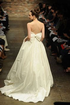 LOVE THE BOW IN THE BACK! I WANT A BIG BOW ON BACK OF MY WEDDING DRESS<3