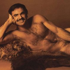 "BURT REYNOLDS ""Cosmopolitan"" infamous 1972 nude photo shoot and CENTERFOLD on a bear skin rug (he was one of the first male actors do such a spread). Burt Reynolds, Caleb Reynolds, Helen Gurley Brown, Michigan, Nostalgia, Cinema, Cosmopolitan Magazine, Raining Men, American Actors"