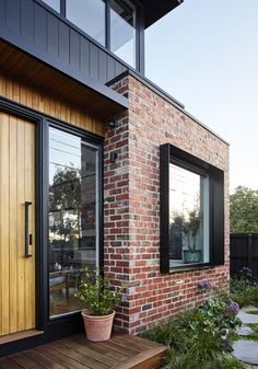 Shou Sugi Ban And Recycled Brick Make This Australian House Stand Out Surrounded by the recycled bricks is a deep steel window box detail that adds depth and shadow to this modern house facade. House Cladding, Facade House, Timber Cladding, Exterior Cladding, Black Cladding, House Windows, Modern House Facades, Modern House Design, Modern Brick House
