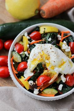 Breakfast Bowl full of farmer's market vegetables and topped with goat cheese and an egg, your way. Gluten-free and vegetarian.