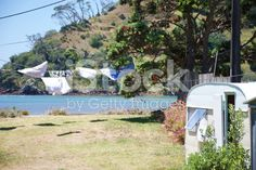 The Kiwi Summer; Caravan by Sea and Washing royalty-free stock photo New Zealand Image, Long Hots, Kiwiana, Image Now, Caravan, Gazebo, Royalty Free Stock Photos, Outdoor Structures, Summer