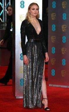 Sophie Turner from 2017 BAFTA Film Awards: Red Carpet Arrivals  TheGame of Thrones star flaunts a plunging neckline and her leg.