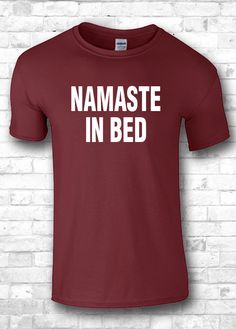 Namaste in bed funny t-shirts  sports apparel by FourSeasonsTshirt