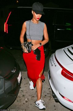 Going out with a bang: Rihanna raised eyebrows with a gun-shaped handbag for dinner at Gio...