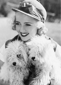 Bette Davis and her dogs, 1930.