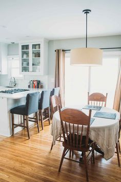 The full reveal of our recent kitchen remodel - updating from a dark, small space to an open, light, white and grey kitchen. | pinchofyum.com
