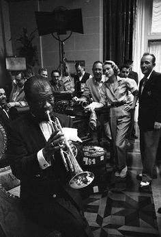 Grace Kelly, Bing Crosby and crew are treated to an impromptu concert by Louis Armstrong, on the MGM set of High Society, 1956.