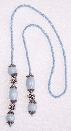 """""""Bluer Shade Of Pale"""" handmade beaded book thong...pastel blue seed beads and glass beads with silvertone flower beads and bead caps."""