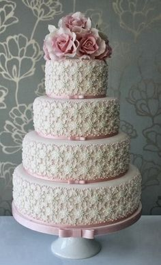 Wedding cake with unique detailing. Love pretty thin pink ribbon on the edges of the layers.