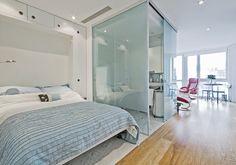 modern studio apartment with glass bathroom