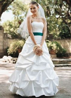 Satin pick-up gown with a ribbon waist accent and no train. White available online and in stores. Ivory available online. Shown with satin sash Style S400 sold separately. Coordinating flower girl: Style FG9309. Sizes 2T-14. To preserve your wedding dreams, try our Wedding Gown Preservation Kit.