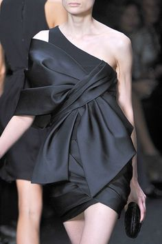 Great black with the perfect knot….by Elie Saab