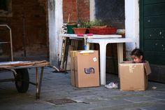 Venice. Girl in a box.