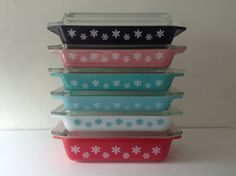 A rainbow of Pyrex! Yep! That is six Pyrex Snowflake Space savers!    I have collected here a beautiful set of vintage pyrex casserole dishes.