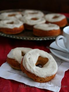 Baked low carb gingerbread donuts with a sweet vanilla cream cheese glaze. Dairy-free and gluten-free.
