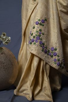 'Biscut cream Raw silk saree' with lailac crochet flower and pearl work embroidery details. Saree Embroidery Design, Hand Embroidery Dress, Embroidery Neck Designs, Creative Embroidery, Beaded Embroidery, Embroidery Patterns, Sari Blouse Designs, Saree Blouse Patterns, Raw Silk Saree